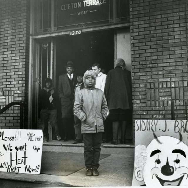 A young resident of Clifton Terrace protests conditions as Mayor Walter Washington exists the building January 1968
